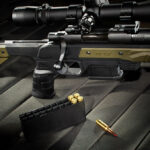 a photo of a bolt action rifle with ammo