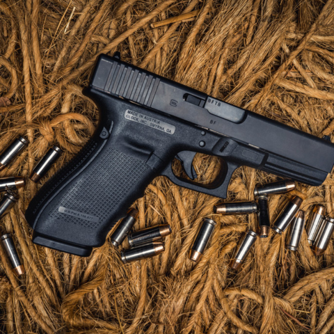 photo of glock 20 10mm pistol on ropes