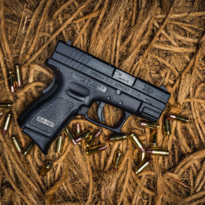 photo of 9mm springfield sub compact xd pistol sitting on ropes