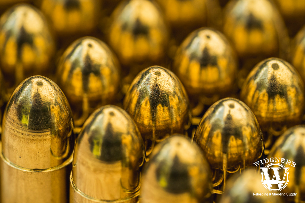 a macro photo of 9mm fmj ammo