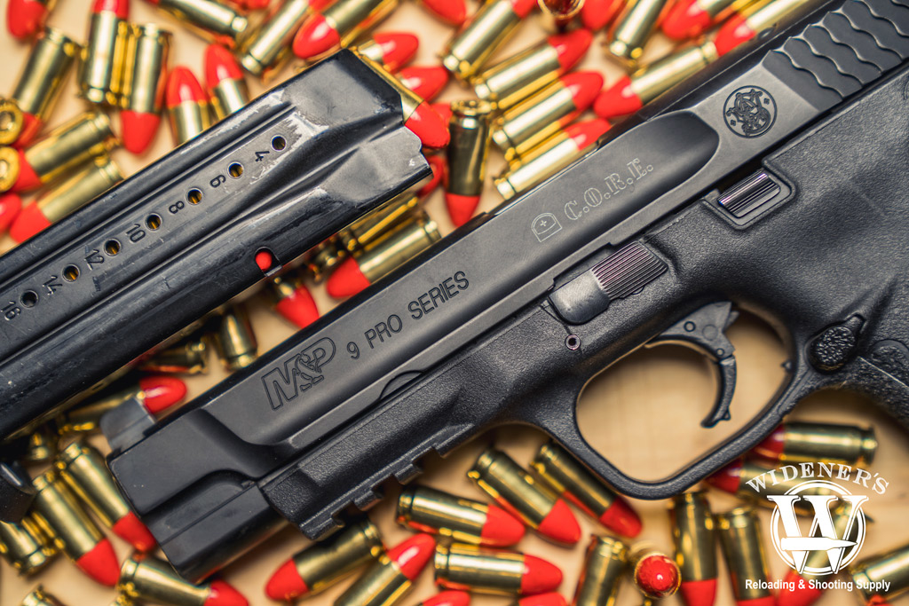 a photo of a smith and wesson M&P 9 pro series pistol with federal syntech ammo