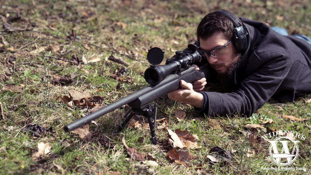 a photo of a man shooting a 300 win mag hunting rifle