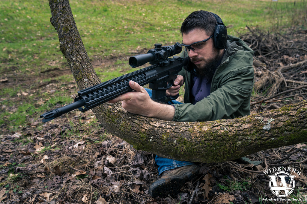 photo of a man shooting a 308 rifle outdoors