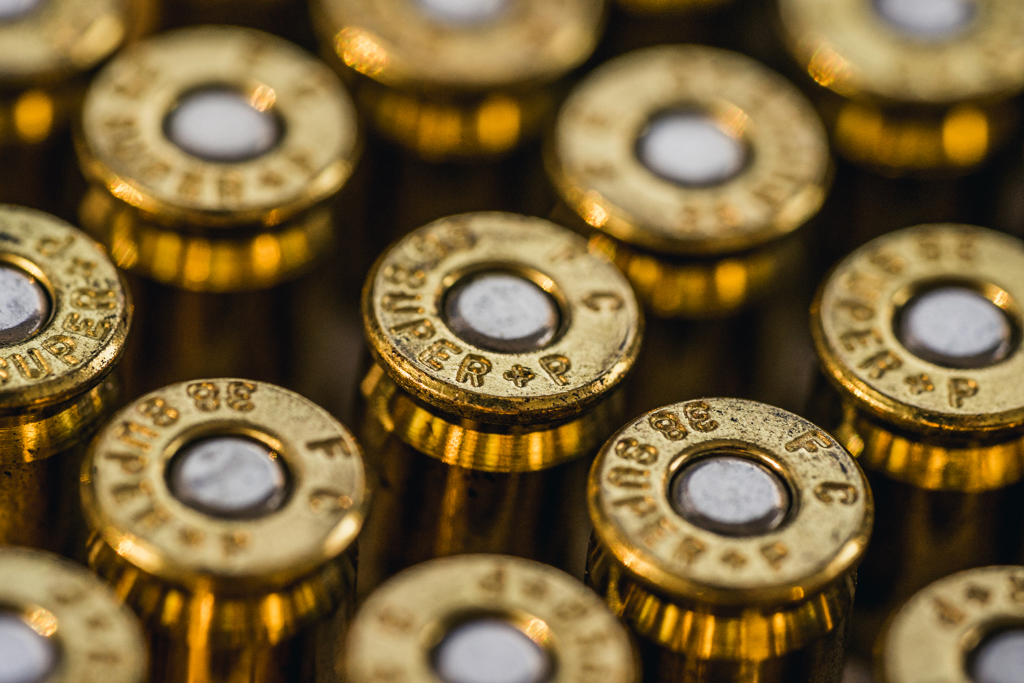 a macro photo of plus p ammo cartridges