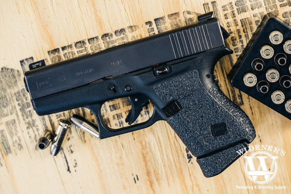 a photo of a glock 43 handgun with 9mm ammo