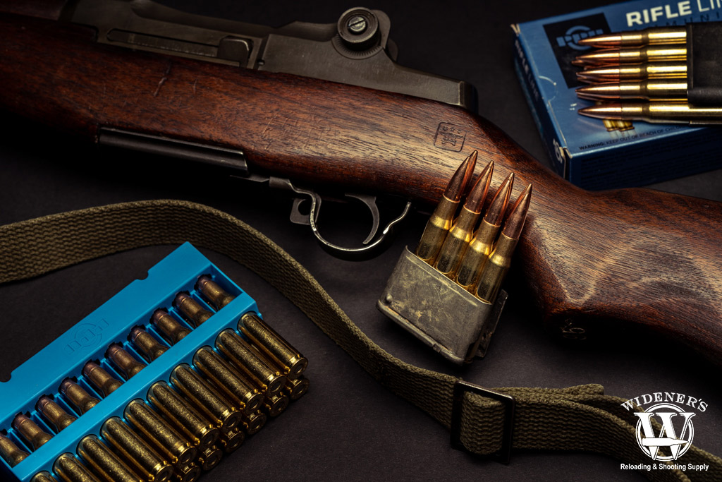 a photo of the m1 garand with magazines and 30-06 ammo