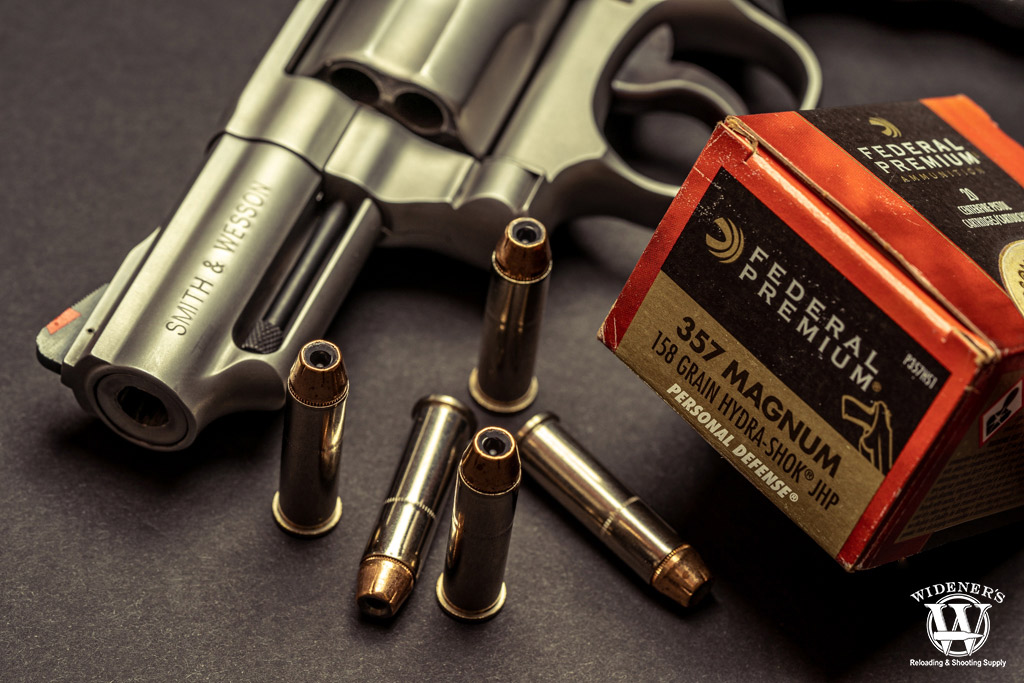 photo of a smith & wesson revolver with federal premium 357 magnum ammo