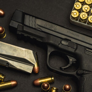 a photo of a smith & wesson M&P 45 acp pistol with ball ammo