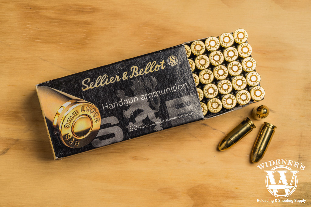 photo of sellier & bellot 9mm 115gr ammo on a sheet of plywood