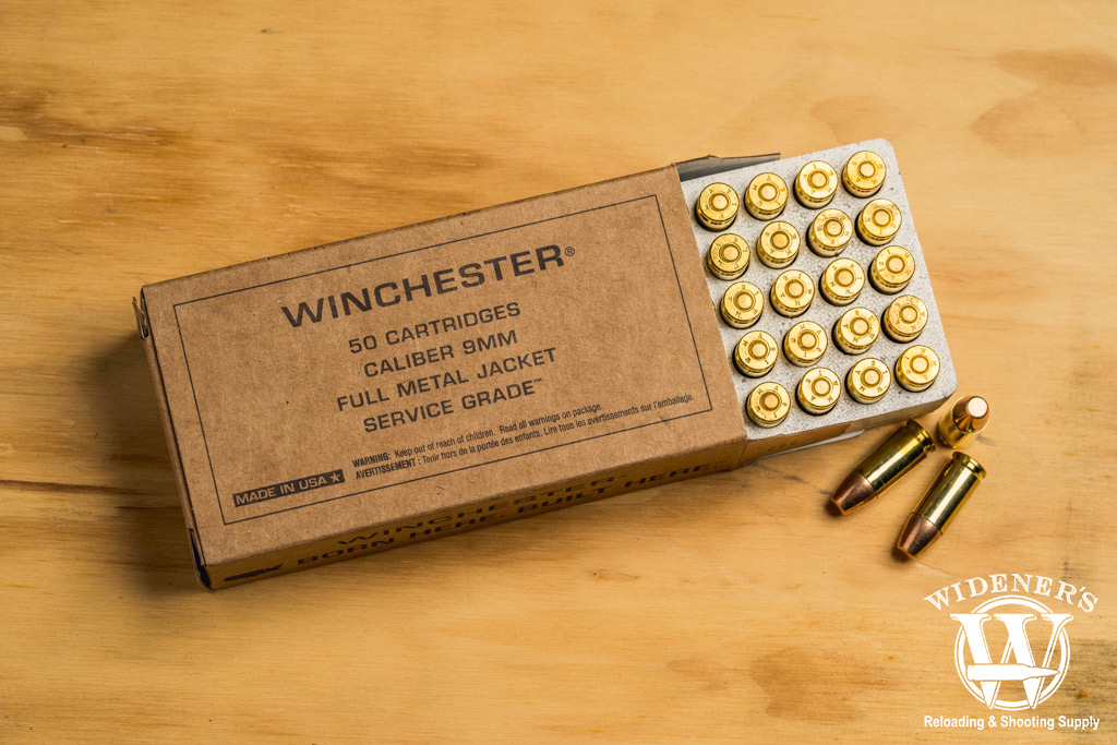 photo of winchester service grade 115gr practice ammo on a sheet of plywood
