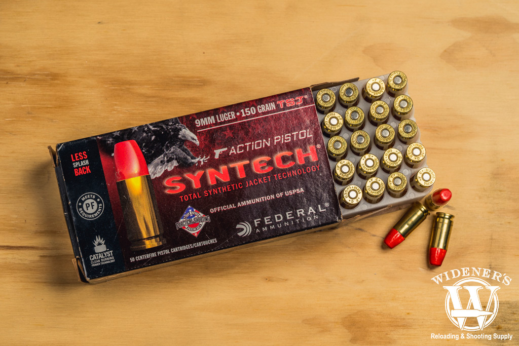 photo of federal syntech 9mm 150gr competition ammo on a sheet of plywood