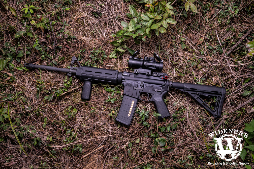 photo of history of the AR-15 rifle with magpul furniture outdoors