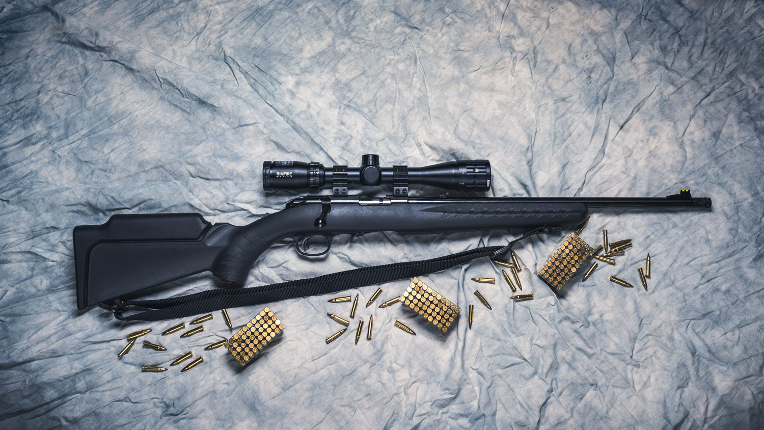 photo of a ruger rimfire rifle with ammo