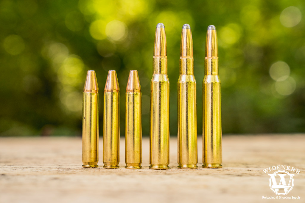 a photo of 350 legend ammo next to 30-06 ammo outdoors