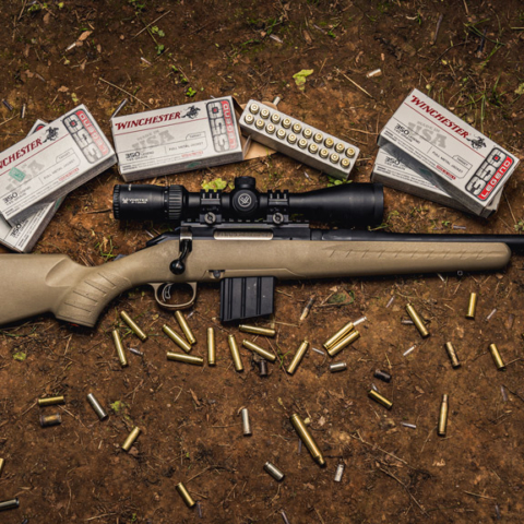 photo of the ruger american ranch rifle next to winchester 350 legend ammo