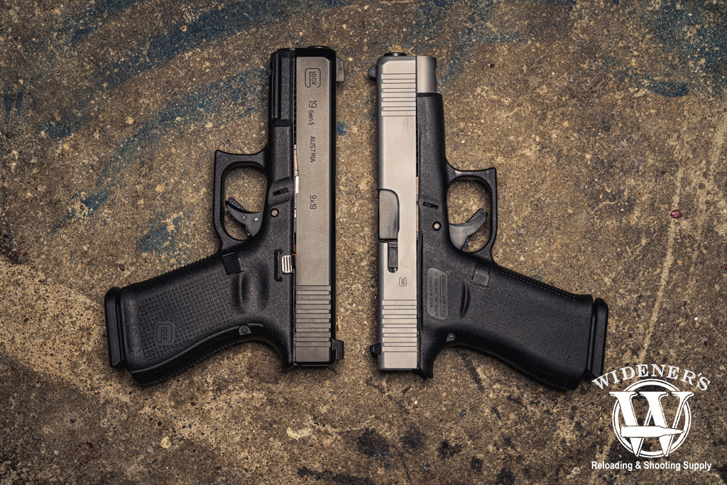 a photo of a glock 48 vs glock 19 on a concrete floor