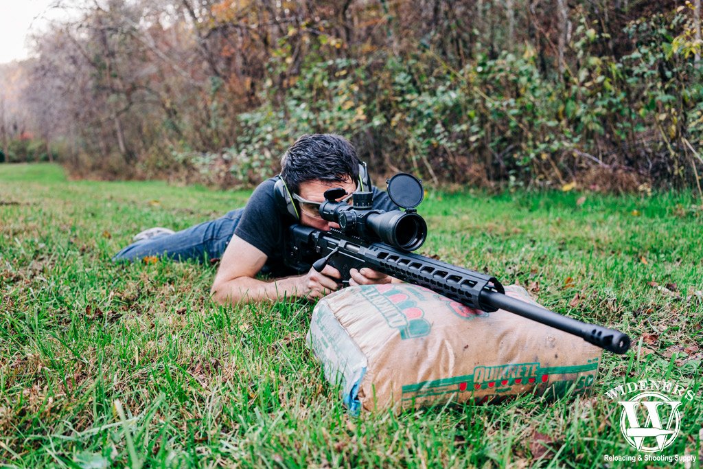 a photo of a man shooting a rifle experiencing the coriolis effect