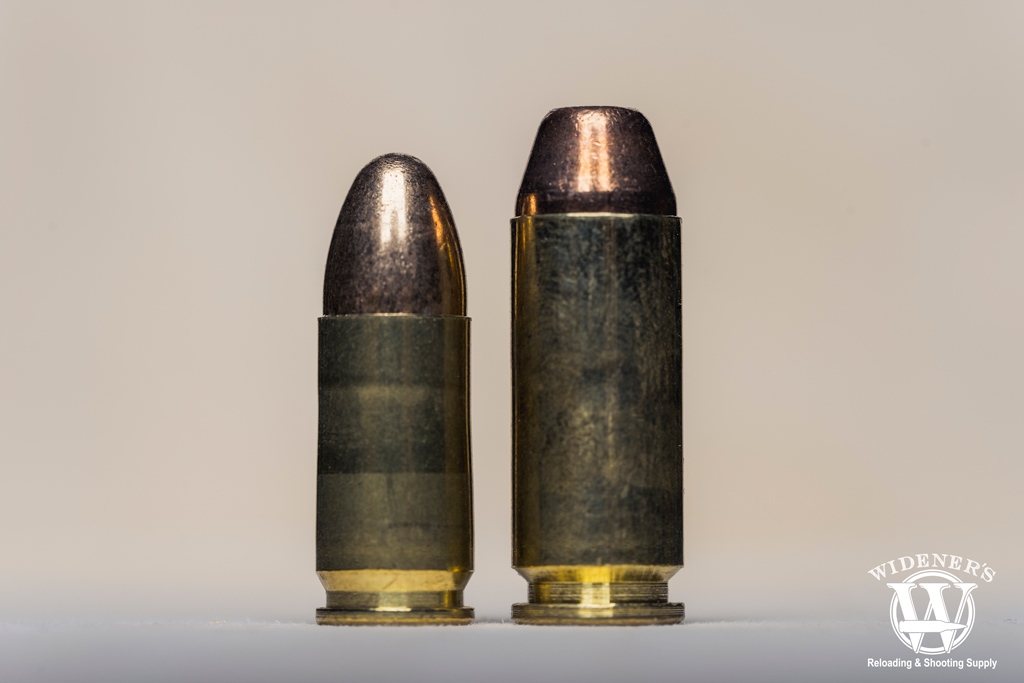 a photo comparing 9mm vs10mm bullets