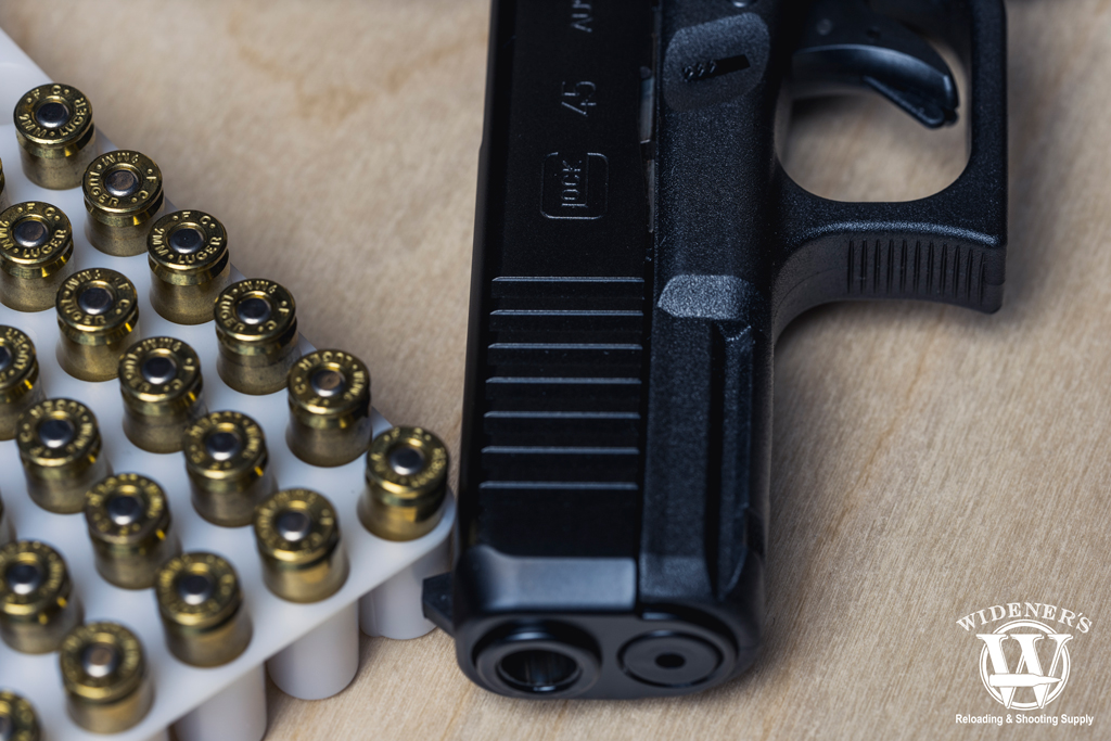 a photo of a glock 45 handgun and 9mm ammo