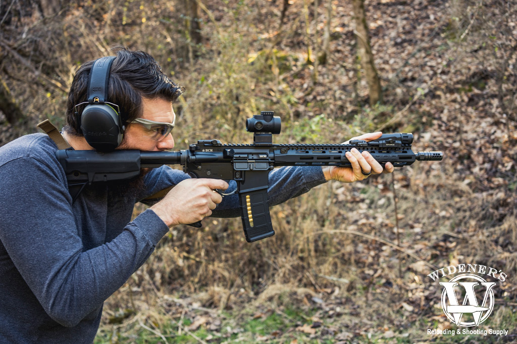 photo of a man shooting an ar-15 outdoors