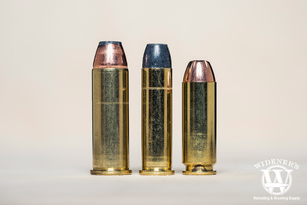 a macro photo comparing magnum ammo