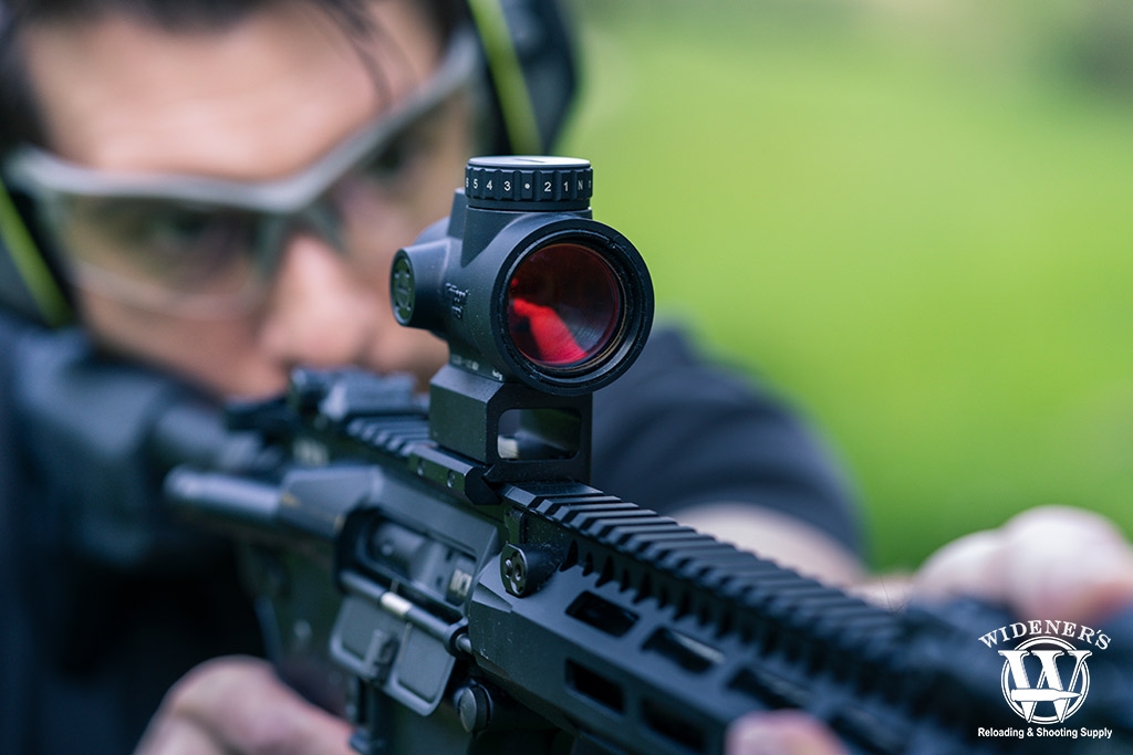 a photo of a rifle with a red dot sight