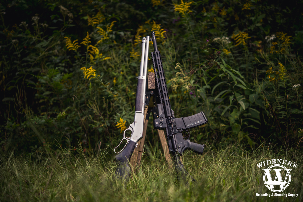a photo of a lever action rifle and an AR rifle 45-70 VS 450 Bushmaster