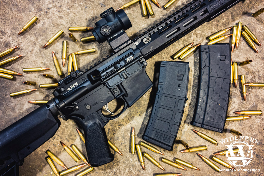 a photo of an ar 15 rifle with polymer magazines
