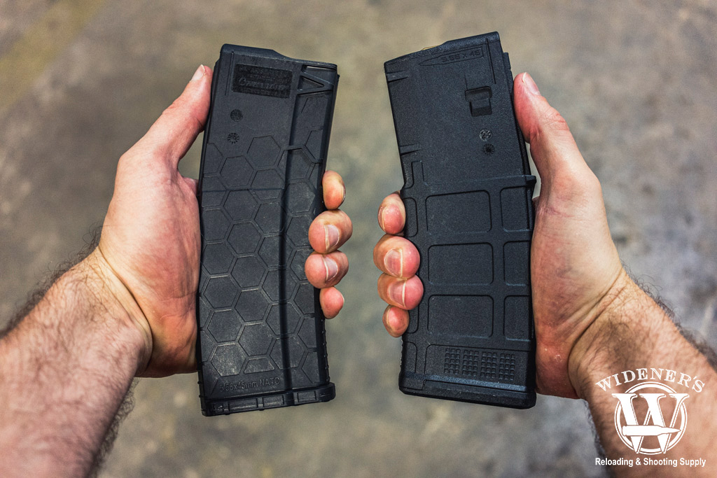 a photo of a man comparing pmag vs hexmag