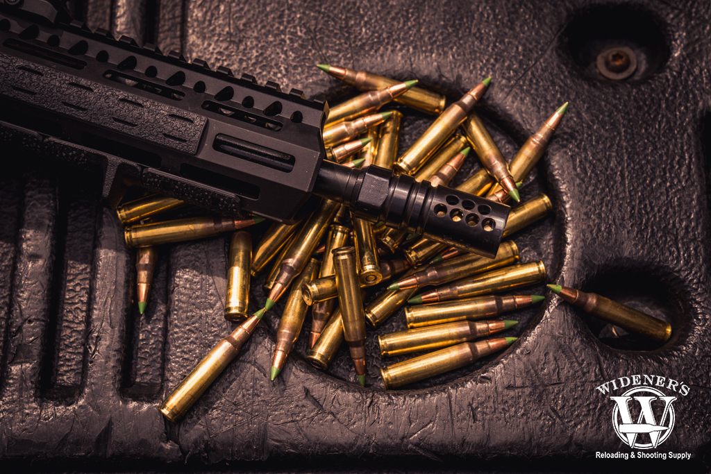 photo of a rifle with compensator and ammo