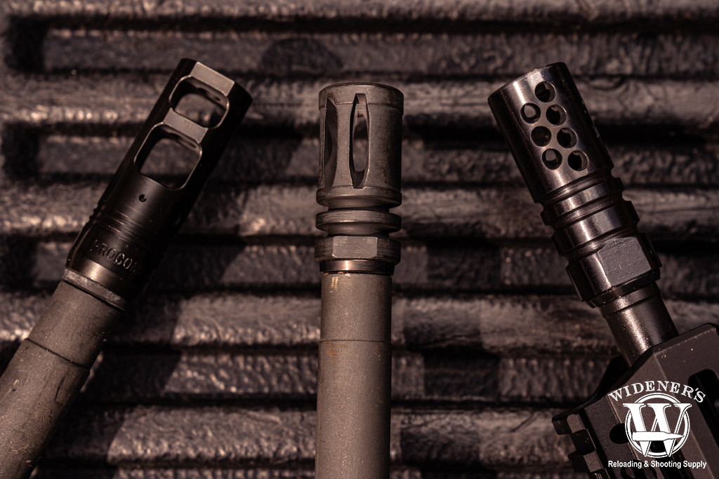 a photo of a flash hider, muzzle break and compensator