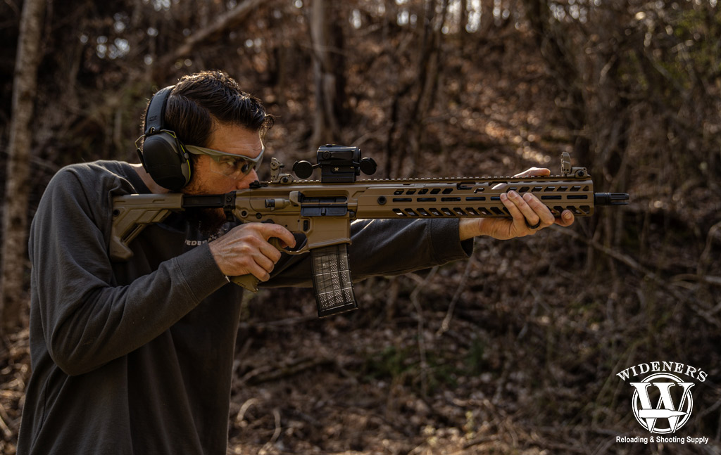 photo of man testing 300 blackout effective range with a rifle outdoors