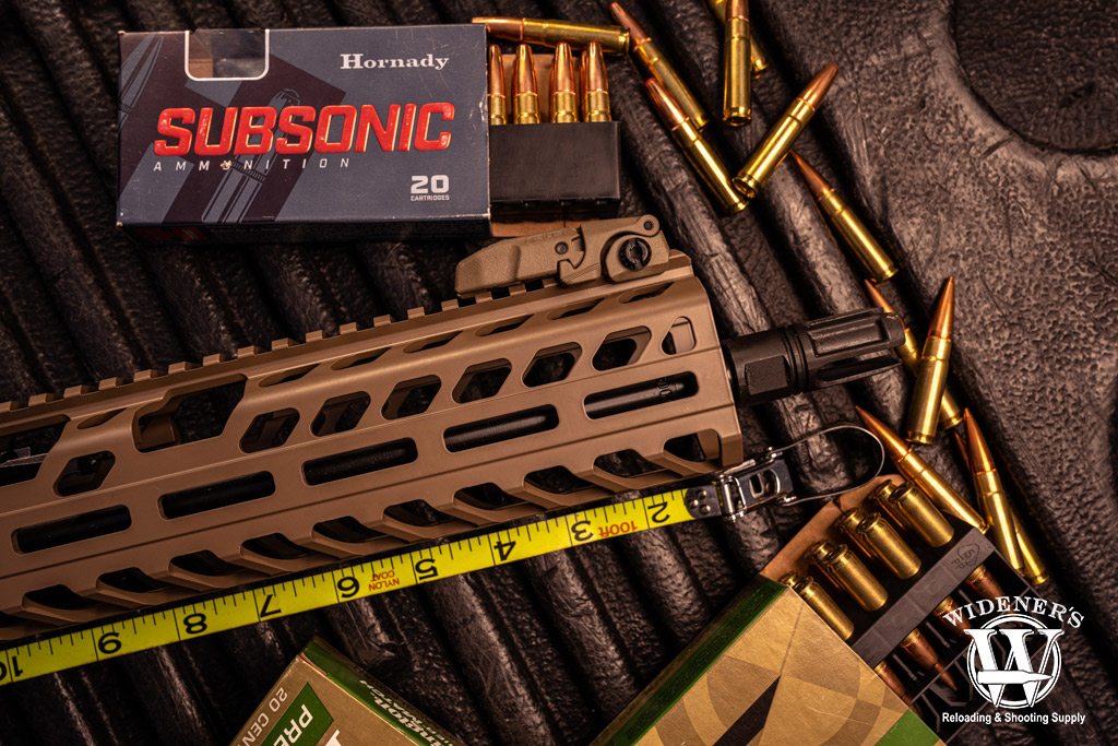 photo of sig sauer rifle and 300 blk ammo