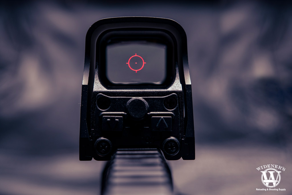 a photo of a holographic sight mounted on a picatinny rail