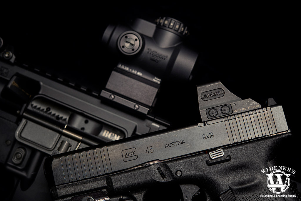 a photo of red dot sights on a pistol and rifle