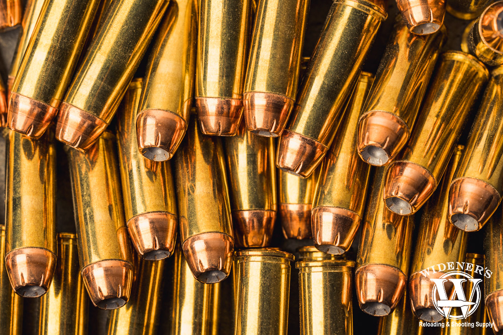 a photo comparing hollow point VS fmj bullets