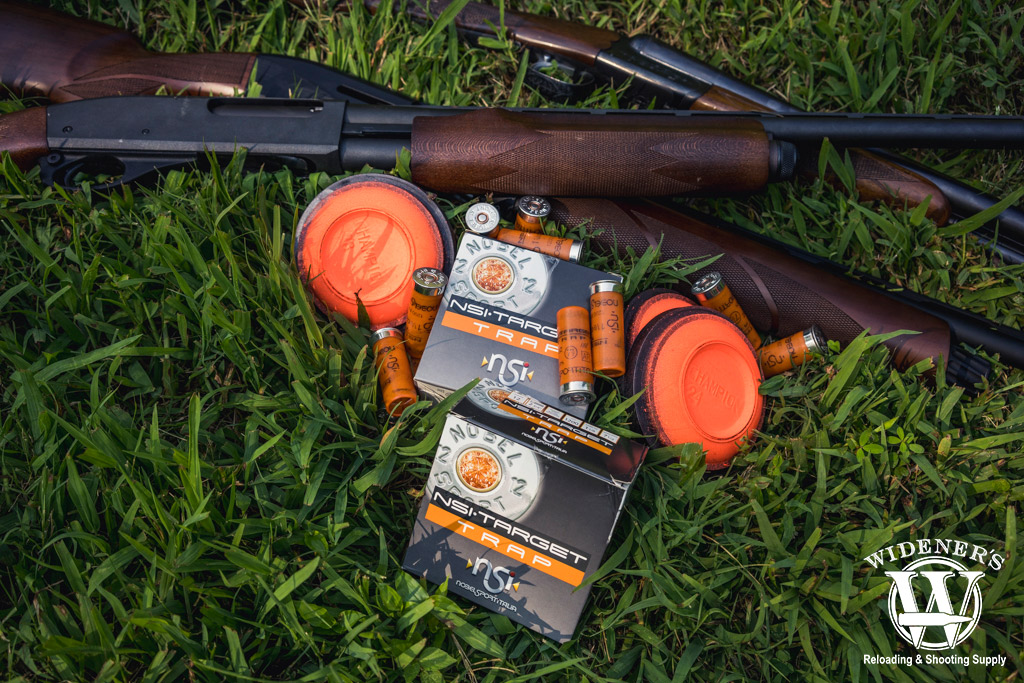 a photo of shotguns with clay targets used in trapshooting