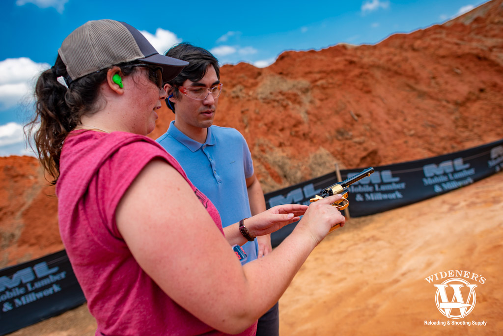 a female instructor teaching conceal and carry classes outdoors with revolver pistol
