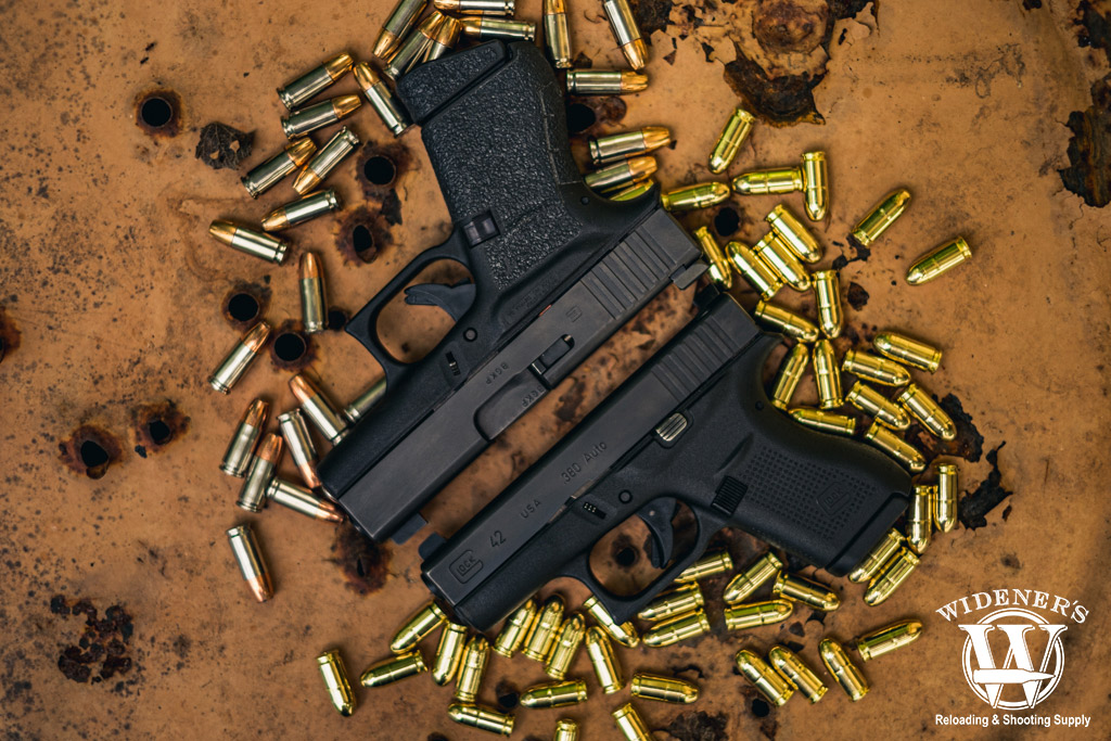 a photo of a glock 42 pistol and a glock 43 pistol with ammo