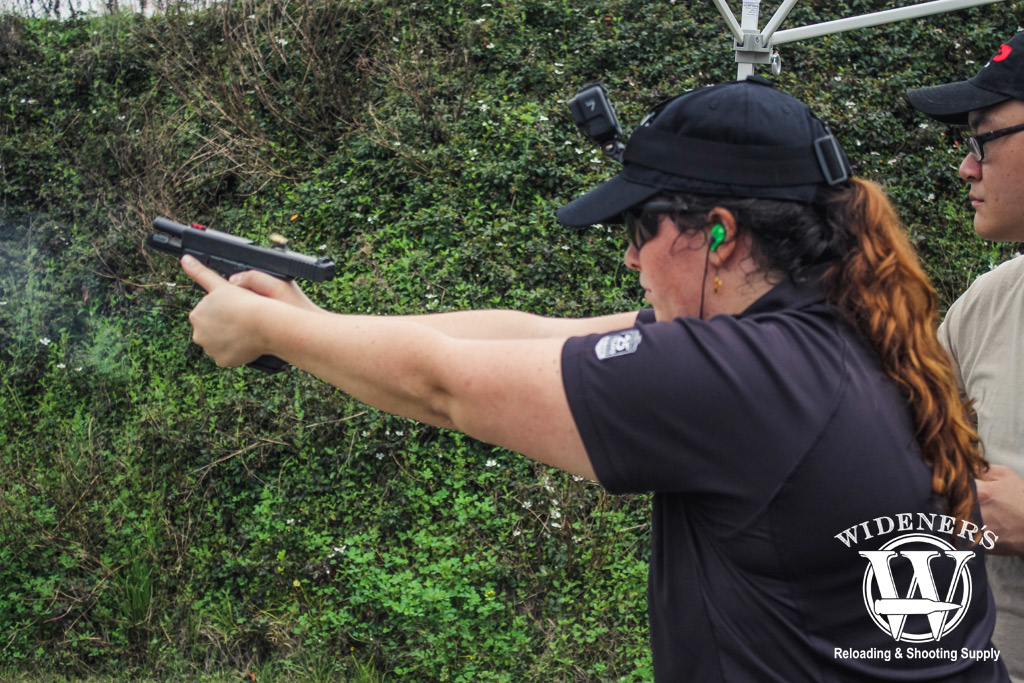 photo of a woman shooting a glock pistol at a gssf match