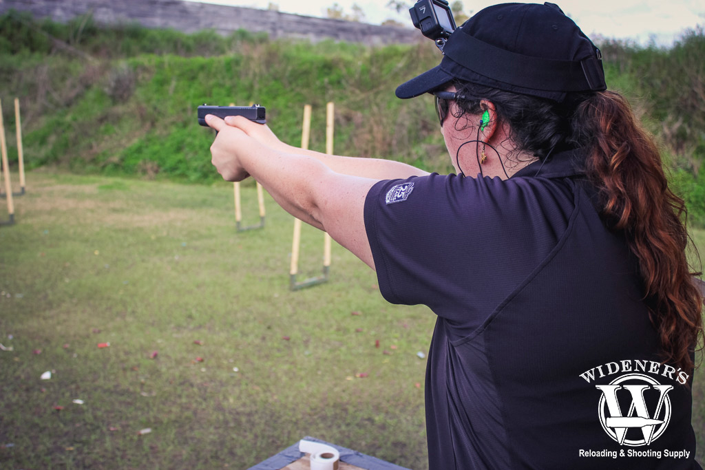 photo of a female competition shooter at a gssf match outdoors