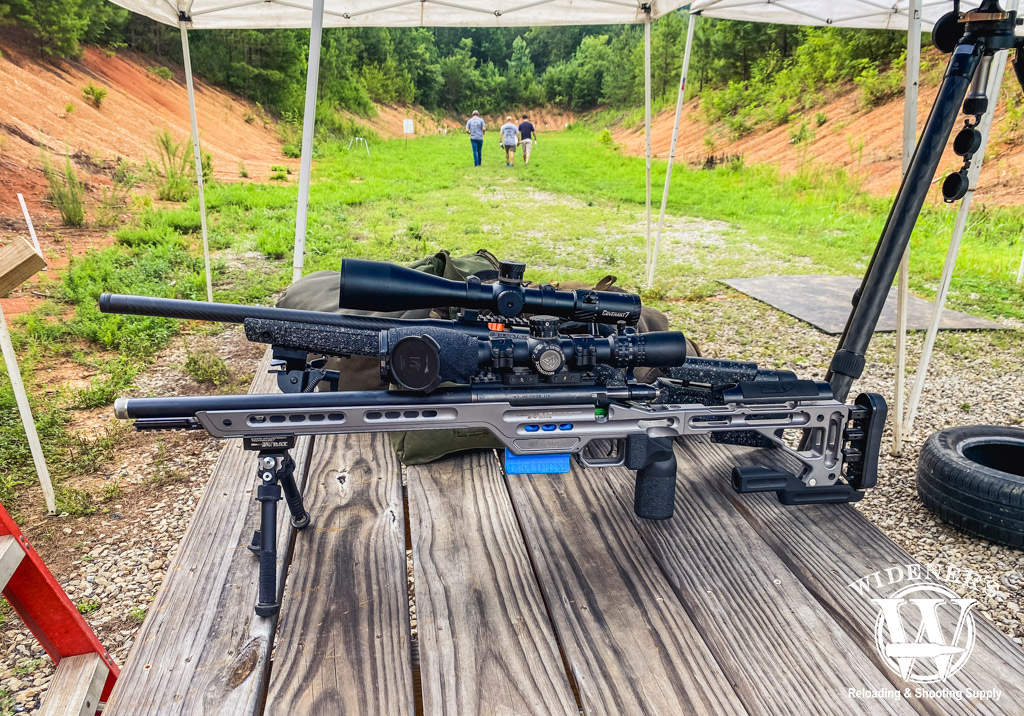 a photo of two bolt-action rifles at a shooting range