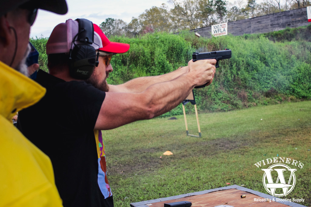 photo of a man shooting a glock pistol at a gssf match