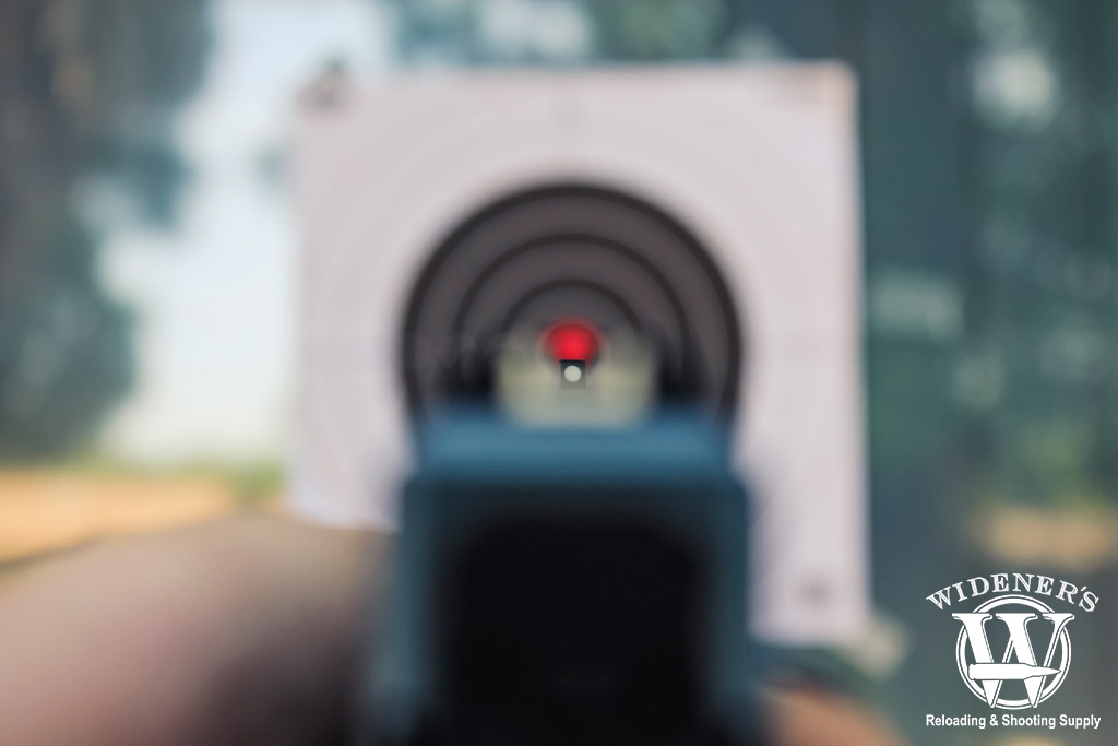 a photo looking down the sights of a pistol at a target