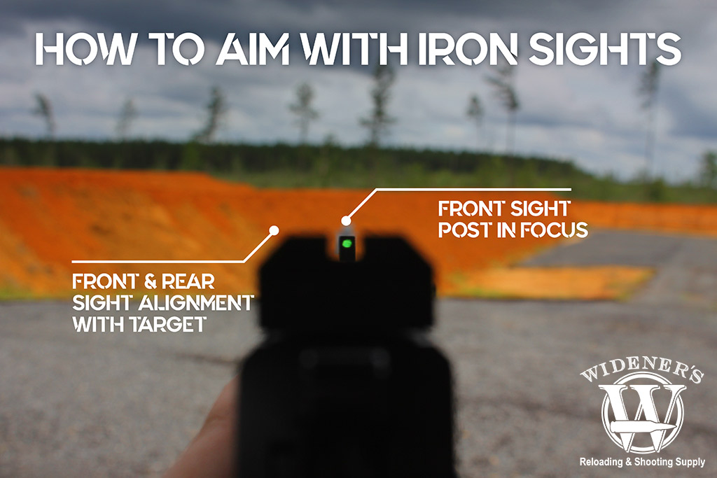 a photo demonstrating how to aim iron sights on a pistol
