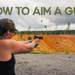 female showing how to aim a gun