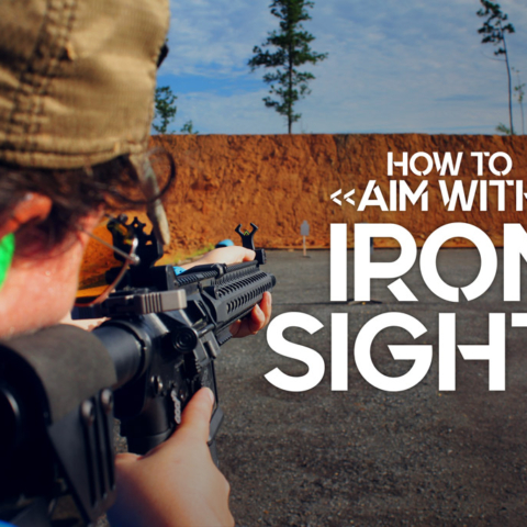 a photo of a female shooter showing how to aim with iron sights