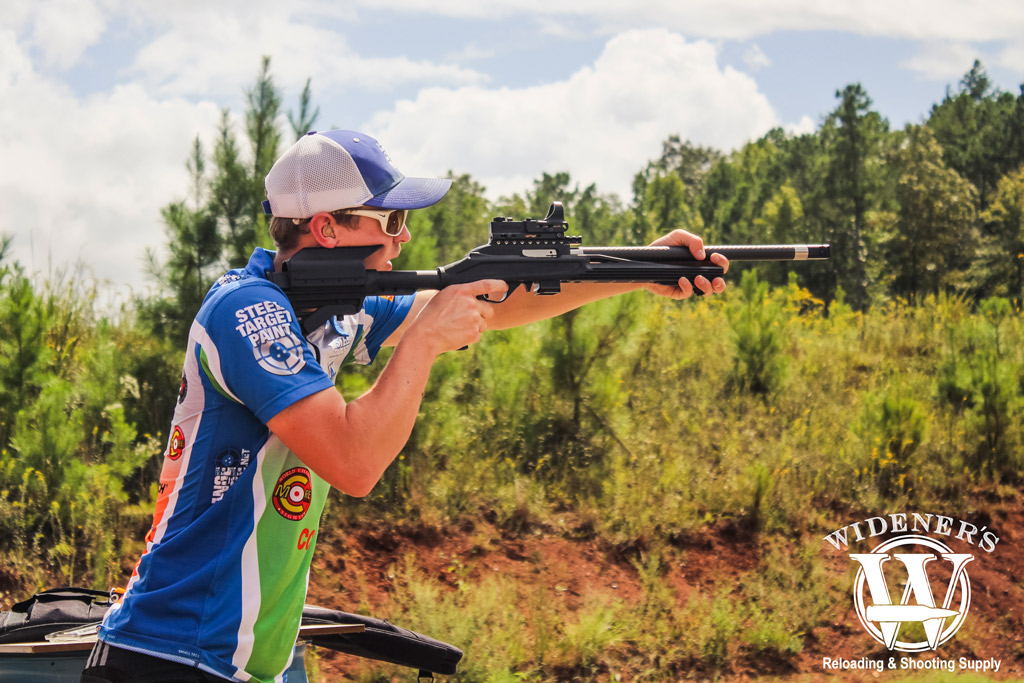 a photo of a male competition shooter at a steel challenge match
