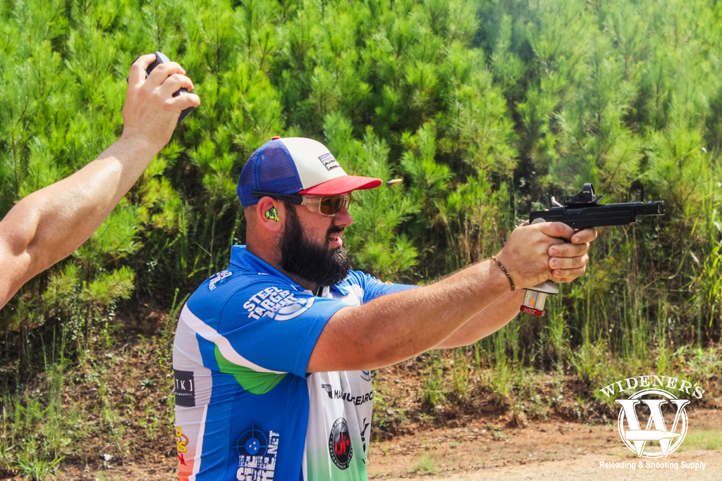 a photo of a male competition shooter at steel challenge