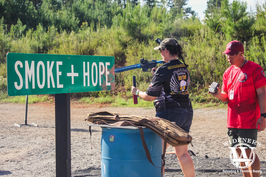 a photo of kenzie fitzpartick shooting a steel challenge competition